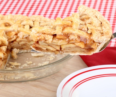 Serving a slice of apple fruit pie Stock Photo - 17222534