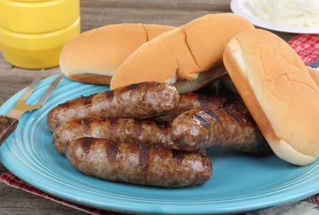 Grilled bratwursts and buns on a platter Stock Photo - 17273225