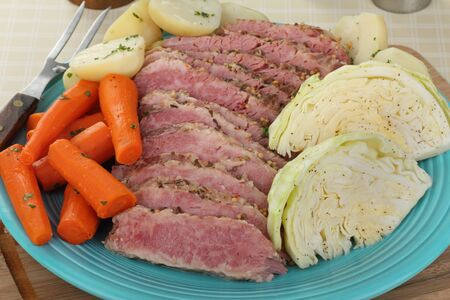Sliced corned beef brisket with cabbage, carrots and potatoes photo