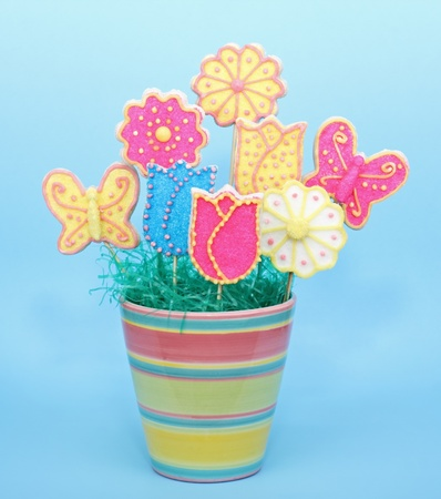 Sugar cookies in a flower pot on a blue background Stock Photo - 17438664