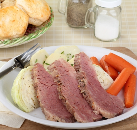 Corned beef and cabbage with carrots and potatoes photo
