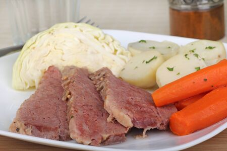 Corned beef meal with cabbage, carrots and potatoes photo