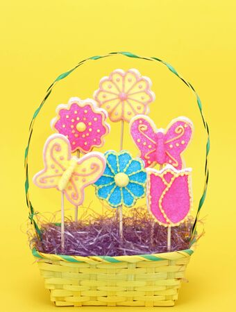 Easter sugar cookies shaped like flowers and butterflies in a basket Stock Photo - 17477036