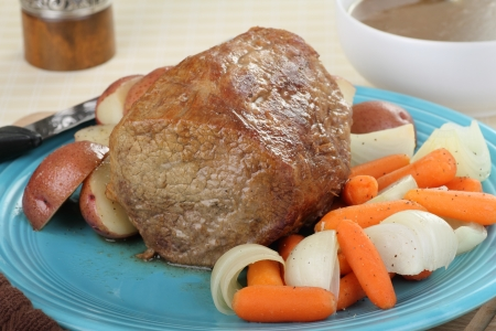 Whole pot roast with vegetables on a platter Stock Photo - 17477038