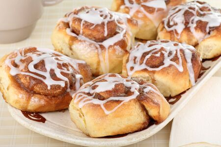 Homemade cinnamon rolls with icing on a tray Stock Photo - 17596847