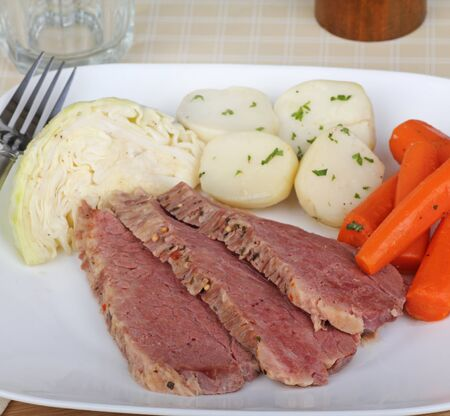 Corned beef and cabbage with carrots and potatoes on a plate photo