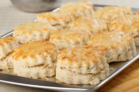Flaky baked homemade biscuits on a baking pan Stock Photo - 17596852