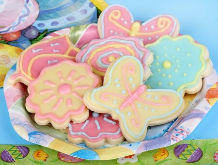 Sugar cookies shaped as flowers and butterflies on an easter plate Stock Photo - 17596854