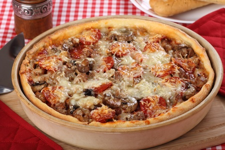 Deep dish pizza with sausage, pepperoni and mushrooms Stock Photo - 17596859