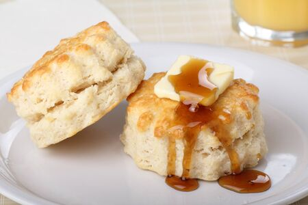 Two flaky biscuits with butter and honey on top Stock Photo - 17596856