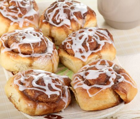 Homemade cinnamon rolls with icing on a plate Stock Photo - 17596858