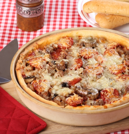 Homemade deep dish pizza with sausage, pepperoni and mushrooms Stock Photo - 17717013