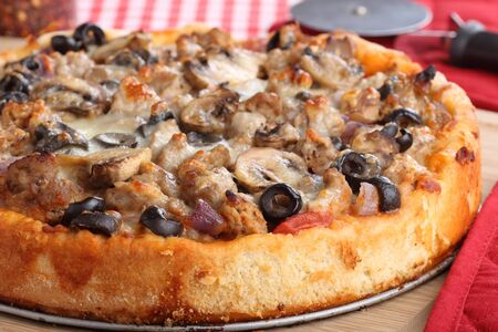 Closeup of a sausage, mushroom and olive pizza Stock Photo - 17717005