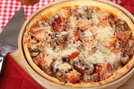Deep dish pan pizza with sausage, pepperoni and mushrooms Stock Photo - 17717010