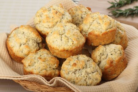 Stack of herb muffins in a basket Stock Photo - 17717009