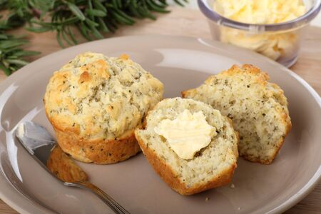 two and a half: Two herb muffins, one cut in half with butter