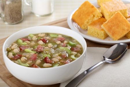 cornbread: Bowl of ham and bean soup with cornbread