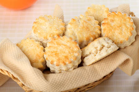 flaky: Golden brown flaky biscuits in a basket Stock Photo