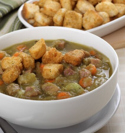 Split pea and ham soup with croutons on top