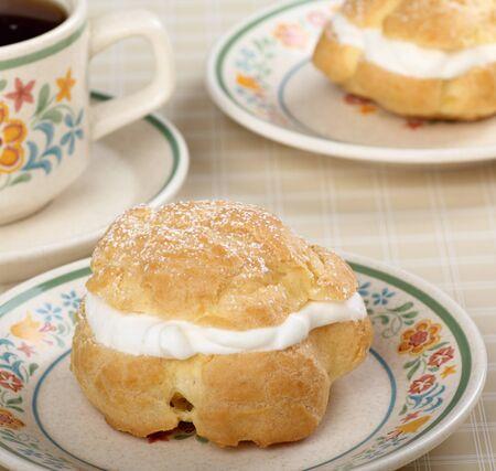 cream puff: Cream puff with powdered sugar on top