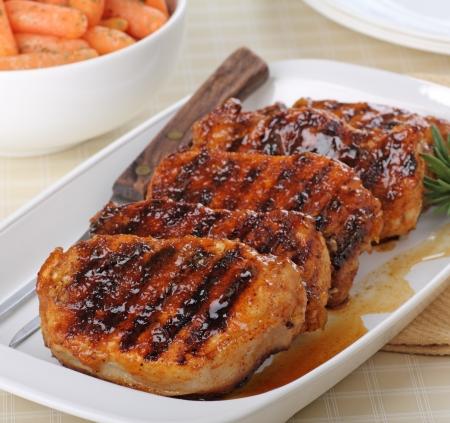 Grilled pork loins on a serving platter