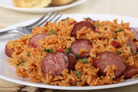 Closeup of a plate of sliced kielbasa sausage and rice