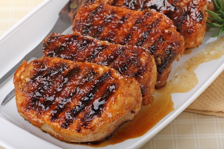 Grilled pork tenderloins on a serving platter