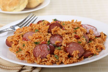 Sliced kielsasa sausage on rice on a plate