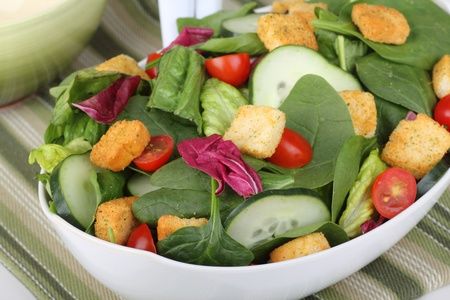 baby spinach: Spinach slad with cucumbers, tomatoes and croutons Stock Photo