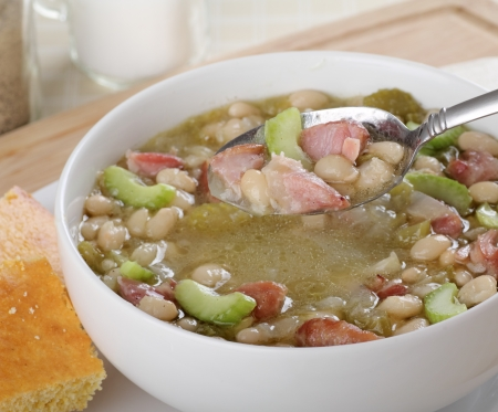 Bowl of ham and bean soup with soup on a spoon Stock fotó