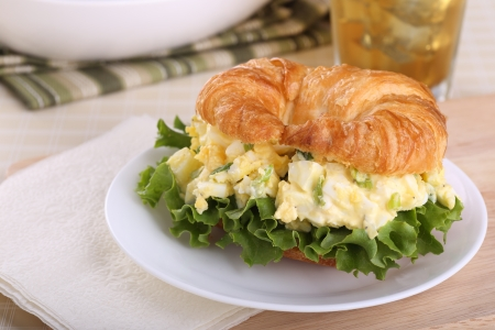 Egg salad with lettuce on a croissant roll Stock Photo