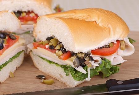 Sandwich with turkey, lettuce, tomato and olives on french bread Reklamní fotografie