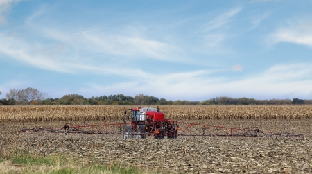 recently: Spraying chemicals onto a recently harvested farm field