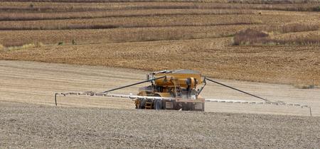 recently: Spraying fertilizer onto a recently harvested farm field