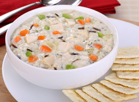 chicken soup: Bowl of chicken and rice soup with carrots and celery