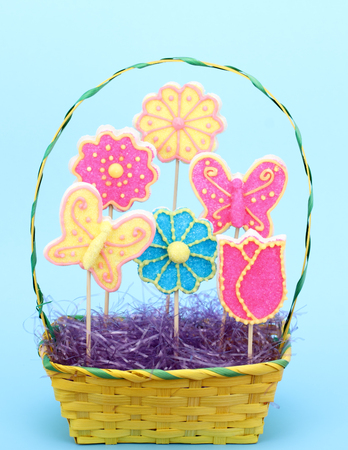 Sugar cookies shaped as flowers and butterfly in an Easter basket photo