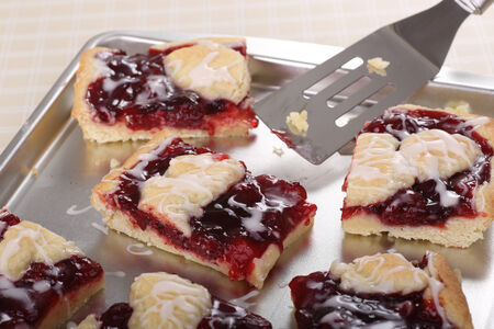 Cherry bars with icing on a baking sheet