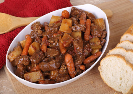 Beef stew with carrots and potatoes in a bowl Stock fotó