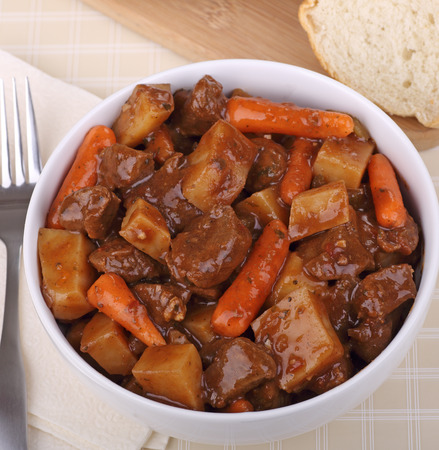 Bowl of beef stew with carrots and potatoes