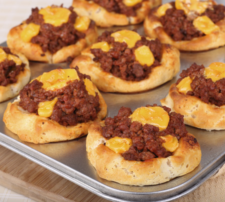 sloppy: Sloppy joe in a biscuit with melted cheese baked in a muffin pan