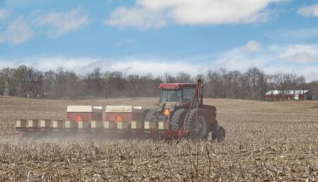 seeding: Tractor seeding corn in a farm field