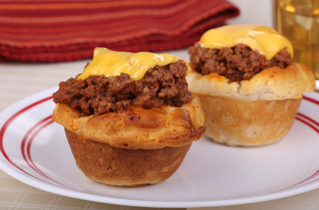 sloppy: Sloppy joe in a biscuit topped with melted cheese Stock Photo