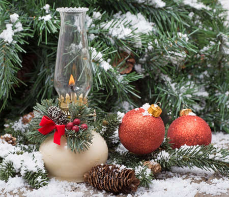 red oil lamp: Christmas oil lamp with holiday decorations and snow
