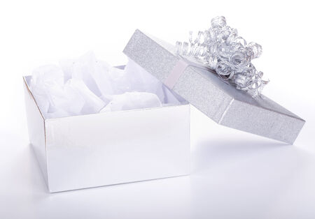 silver ribbon: Opened silver gift box on a white background Stock Photo