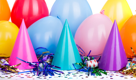 Party decorations of hats, noisemakers, confetti and balloons Stock Photo