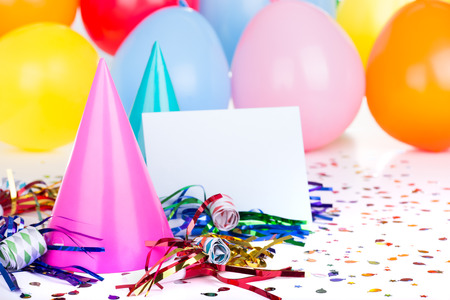 Birthday party decorations with a blank envelope