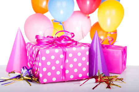 Pink birthday gift with party decorations photo