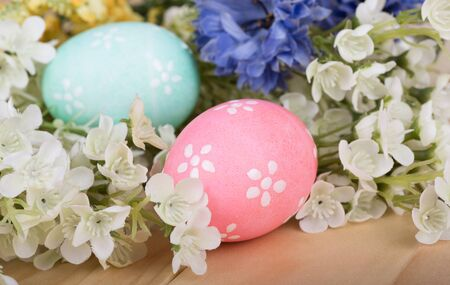 Two colored Easter eggs among colorful flowers Banco de Imagens