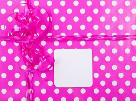Birthday gift wrap background with a blank note card