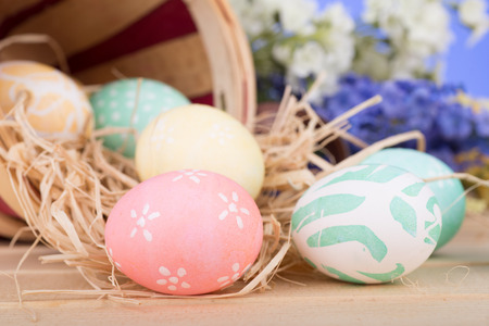 Decorated Easter eggs spilled from a basket Banco de Imagens